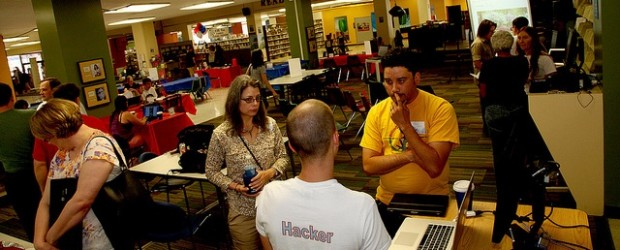 A 'hacker' speaks with community members during a Tulsa, Oklahoma event for the National Day of Civic Hacking.