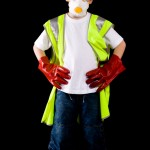 Young man looking at camera up dressed in protective workwear