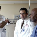 1024px-Doctor_consults_with_patient_(1)