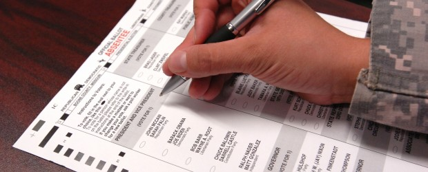 Soldier fills out an absentee ballot